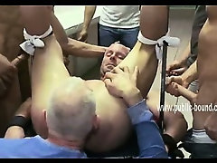 Strong gay men sit on a corridor with hard dicks waitting for sex slave ass in gangbang sex video