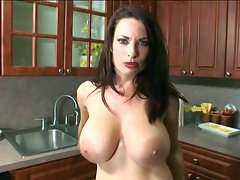 Big and busty Carol Crow uses her massive milky jugs for a titty fuck