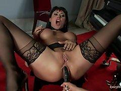 Isis Love thrusts her dildo deep in Eva Karera's ass