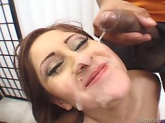 Succulent brunette gets her face sprayed with hot jizz