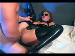 Brunette in uniform fucking in latex lingerie and glove