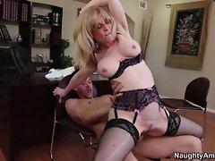 Blistering Nina Hartley rides this prick up her snatch