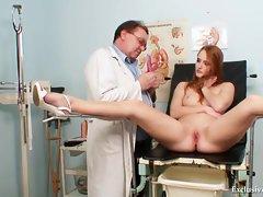Redhead Denisa gyno pussy speculum examination at clini