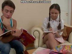 Cute girl with pigtails fucks in the armchair