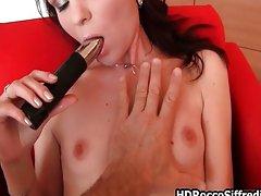 Teen girl fucking her own wet pussy