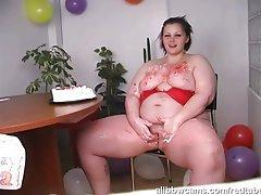 Big birthday girl masturbates with her cake