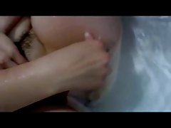 Lisa Tasker squeezing milk in the bath