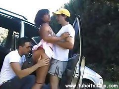 Cute brunette picked up and gets felt up and licked by two dudes outside