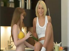Lesbian beauties playing with cucumber
