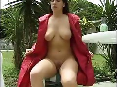Busty brunette Alicia is outside and goes pee on the ground