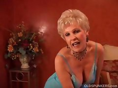 Mature blonde cougar puts on a slow striptease on her webcam