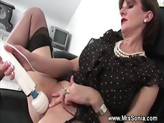 Older teacher playing with her pussy