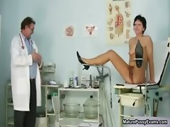 Doctor inserts a speculum