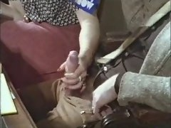 Lad gets a handjob in a retro vintage porno