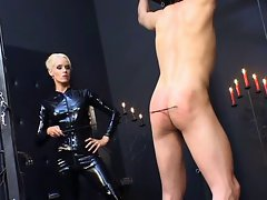 Domina in latex catsuit torturing poor slave