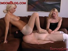 Two light-haired Femdom slave humble strap-on face sitting