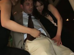 Two sensual Sensual japanese slutty chicks show a attractive businessman the sights
