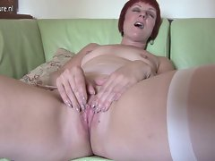 Red mature whore mamma playing on her bed