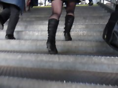Following sensual lass wearing Ebony Skirt, Boots & Stockings