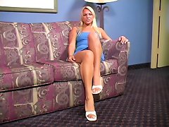 Blond Veronica soft legs on the sofa JOI