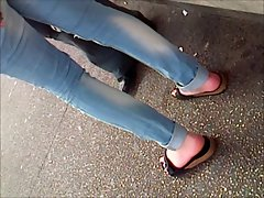 Sensual feet in birkenstocks waiting for the tramway