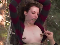 Bound and helpless, Kristine must let her big titties be man-handled