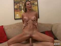 Temptress Brenda James rides this cock up her minge