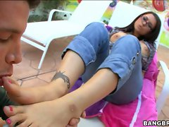 Hot Eva Angelina's boyfriend worships her sexy toes and feet.