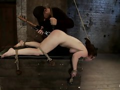 Dominated whore gets a huge toy rammed with her cunt