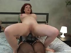 Sexy bitch that loves anal fuck herself with a large black strap-on