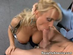Holly Halston and her big tits straddle a man to suck him off