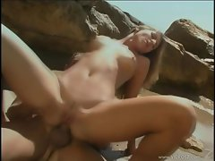 Jennifer Stone cums as she grinds her cunt on a thick cock while on the beach