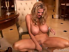 Kelly Madison gets off red dress and toys twat