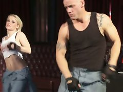 Ash Hollywood dancing with hunky bald guy