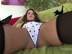 Tweety Valentine in polka dots undies sits on couch