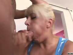 Gorgeous blonde chokes on a massive fuck stick