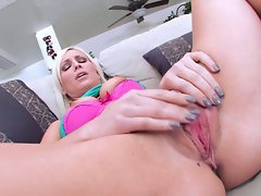 Lexi Swallow busty babe alone on couch finger her cunt