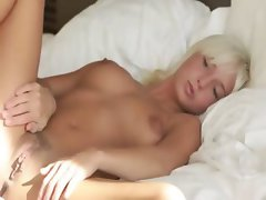 Blonde pornstar spreads pink pussy
