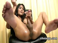 Lusty shemale rubbing dick on a chair