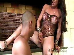 Hot shemale dominatrix Juliana Souza makes stud kneel and suck