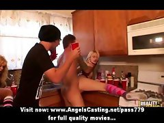 Sexy blonde girls having an orgy with more boys in the kitchen