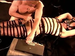 I apply my custom electrostim machine to my buddy's balls while I have him in leather restraints.