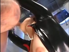 Asian in latex catsuit gets fingered