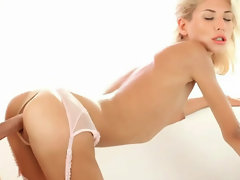 Teen wearing a sexy lingerie gets pussy screwed in mulitiple poses