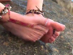 Girl showing beautiful feet on the beach and masturbates