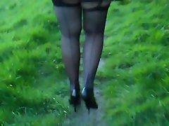 seamed stockings pleated miniskirt