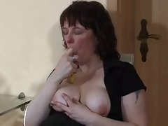 Sexy chubby mom in boots inserting and squirting