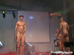 Two male strippers dancing dirty on the stage