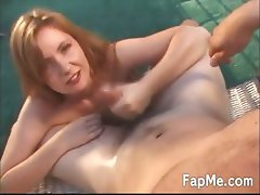 Horny girl wanking a cock outdoors