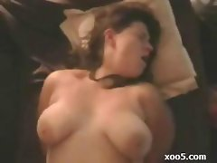 Chunky chick does a blowjob and a titty fuck on her guy's bone